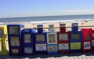 Newspapers on beach
